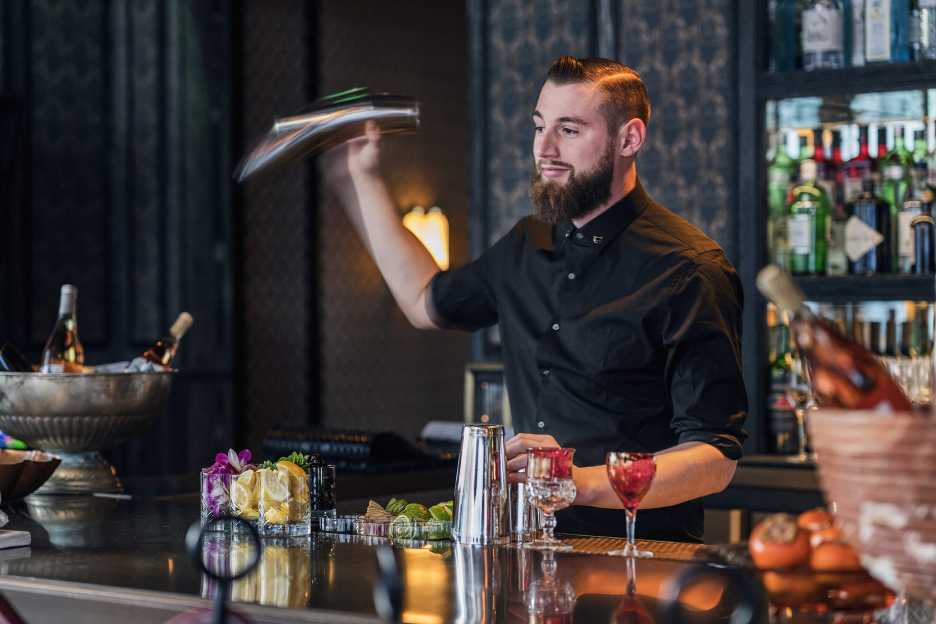 Bartender creating a drink at Proper Hotel
