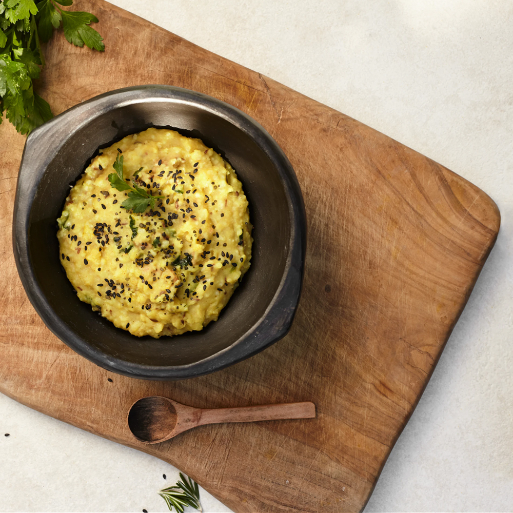 Bowl with entree on wooden board
