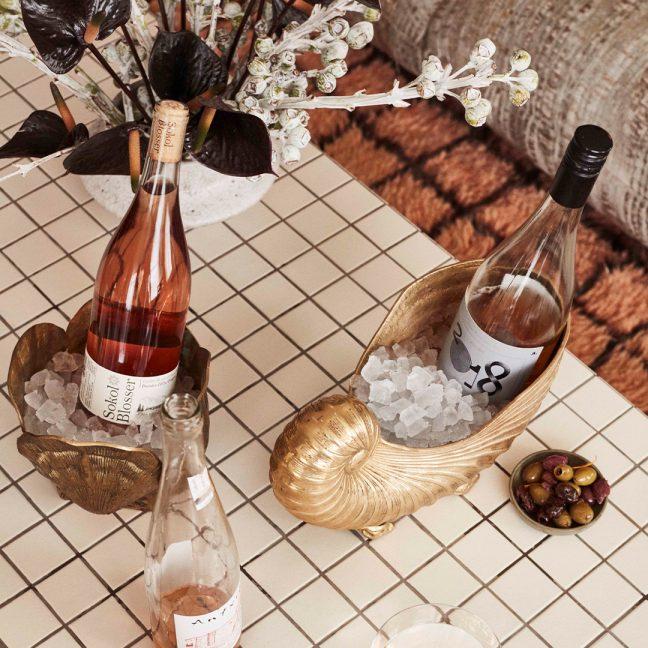 various bottles of rosé wine on low top table