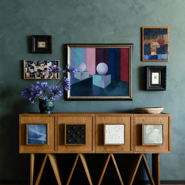 decorative counter top with picture frames behind